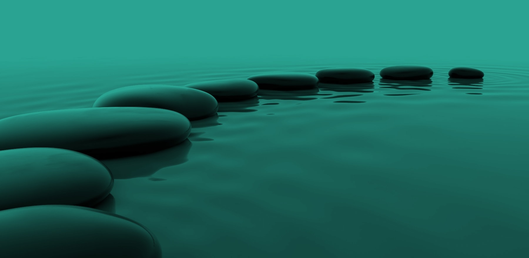 stones on water representing the path to wellbeing with sophrology